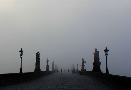 Charles Bridge in fog Photo by Timea Peter — National Geographic Your Shot