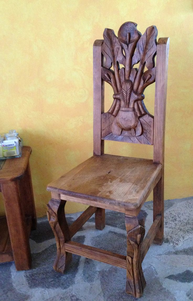 Hand carved chair, reflecting Mexican colonial Baroque style.