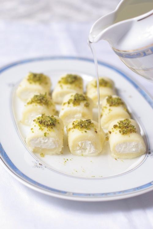Halawet el jeben - Lebanese dessert made out of cheese dough, ashta custard and rose jam.