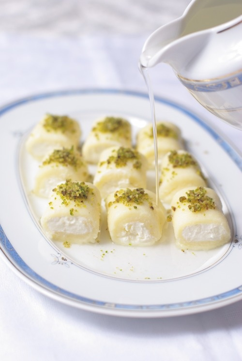 Halawet el jeben - Lebanese dessert made out of cheese dough, ashta custard and rose jam.