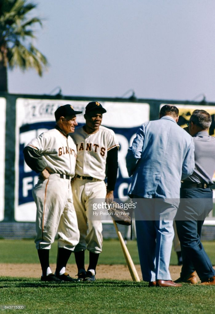 Manager Leo Durocher #2 and Willie Mays #24 of the New York Giants talk to the media during Spring Training on March 2, 1955 in Phoenix, Arizona