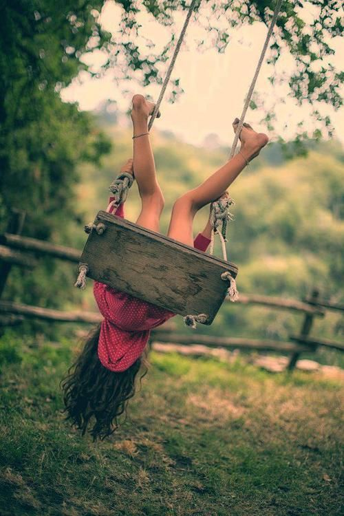 this was my idea of fun when I was a brave little girl... sometimes, I would let go of the chain and flip out onto the earth. I also would swing as high as I might and then jump (fly) free.