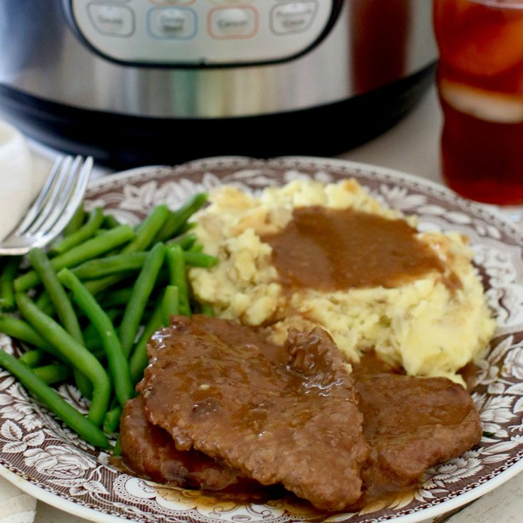 This Instant Pot Cubed Steak and Gravy is so tender and delicious thanks to the quick work of the pressure cooker. The gravy takes it over the top!