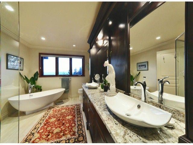 A complete rehaul of a lovely ensuite bathroom. Standalone tub and vessel sink, plus granite counters add luxury and make it a true retreat.  Countertops by Patra Stone Works.  #bathroom #design