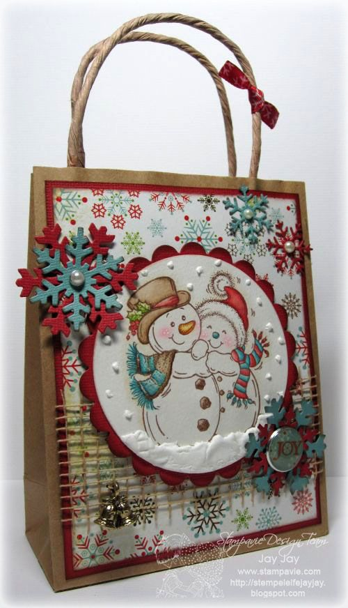 "Gift bag using ""Snowy Cuddles"" by Penny Johnson. Added some light brown jute ribbon, a bell charm and some brads. The snowflakes have been cut with the die-namics snowflake trio shape by MFT."