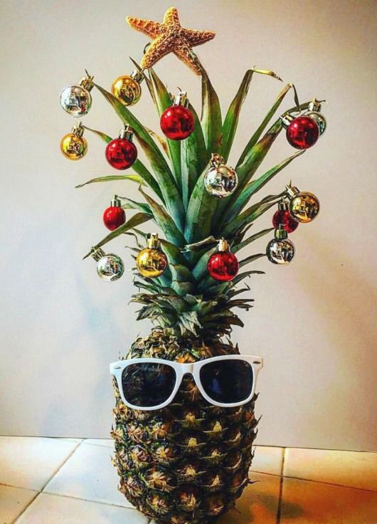 Fun Pineapple Christmas Tree Idea with a Tropical Island Flair... http://www.completely-coastal.com/2016/12/cute-coastal-christmas-trees-diy-shop.html