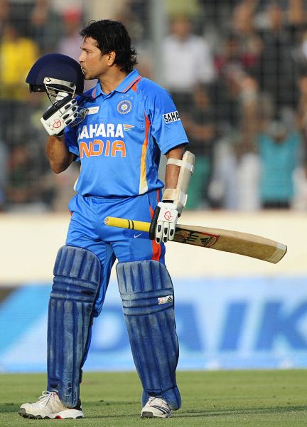 Sachin Tendulkar kisses his helmet after reaching his 100th hundred, Bangladesh v India, Asia Cup, Mirpur, March 16, 2012©AFP  — at Mirpur Cricket Stadium.
