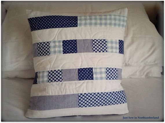 A fantastic blue and white patchwork cushion, suitable for a variety of schemes. This is a unique creation by Just Sew in Northumberland, loving hand-crafted for you  Envelope style cover. Approx. 40cms x 40cms  Catherine