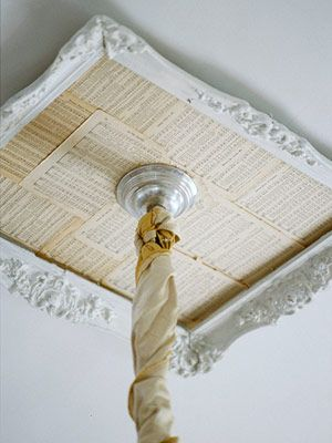 Make a ceiling medallion by painting an old frame white. Then layer pages of sheet music inside. Singing...So cool!