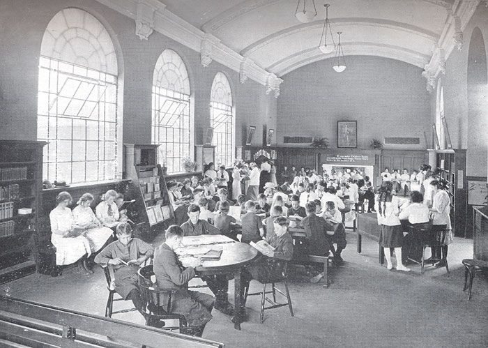 Bloor Gladstone Branch - original children's room of Bloor Dovercourt - notice the working fire place in the background. Dovercourt (now Bloor/Gladstone) Branch opens on October 23 1913, featuring the first children's room planned by Lillian H. Smith. In 1917, the children's room is moved to larger quarters in the basement, taking over the old lecture room.