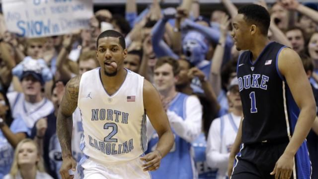 North Carolina's Leslie McDonald (2) reacts following a basket, next to Duke's Jabari Parker (1) during the first half of an NCAA college basketball game in Chapel Hill, 02/20/14. UNC beat Duke 74-66.
