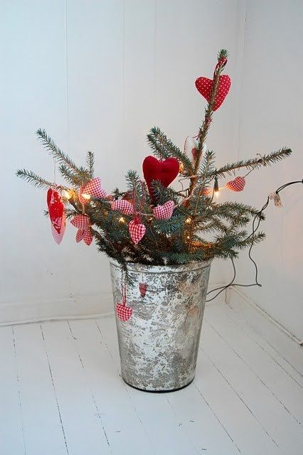 I am Swedish! I already do this! Cute with bucket. I use a vase. 76 Inspiring Scandinavian Christmas Decorating Ideas | DigsDigs