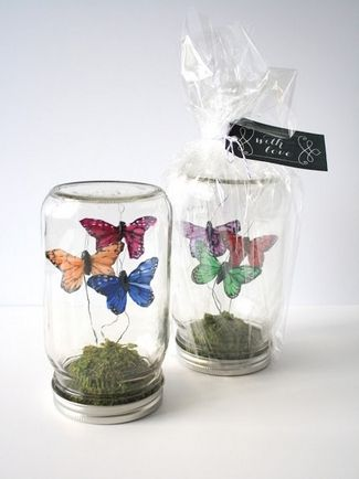 DIY Mason Jar Butterfly Terrarium - Create these adorable butterfly terrariums in mason jars for your table decor or hand them out as wedding favors. Get the DIY here.  - 21 DIY Butterflies Wedding Theme & Ideas | Confetti Daydreams