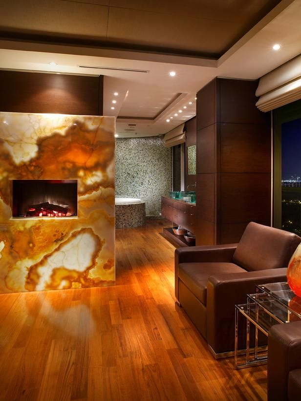A backlit onyx fireplace serves as the divider between bedroom and bathroom, structural columns wrapped in wood, and dropped ceilings or pockets to house window treatments.Fireplaces Design, Modern Bathroom, Nature Stones, Interiors Design, Pepe Calderin, Fireplaces Surroundings, Onyx Fireplaces, Bathroom Fireplaces, Master Bathroom