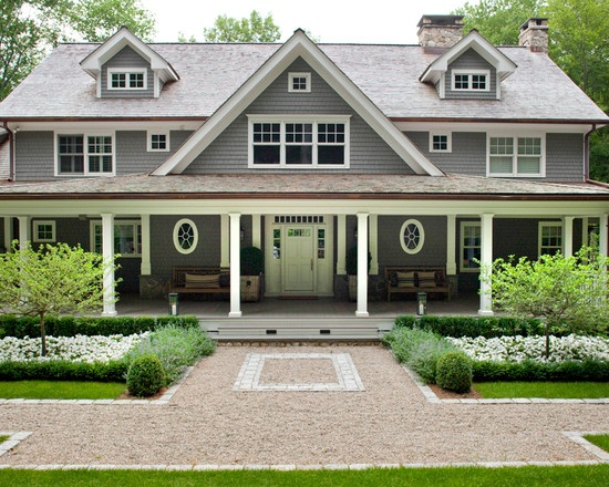 symmetry and all of the cute little windows and dormers. plus basic  rectangular shape plus front porch. - traditional - Exterior - New York -  James ...