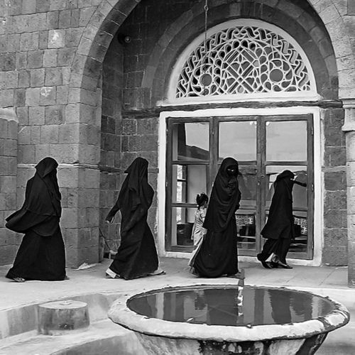 Women in hijab / abaya entering the mosque.