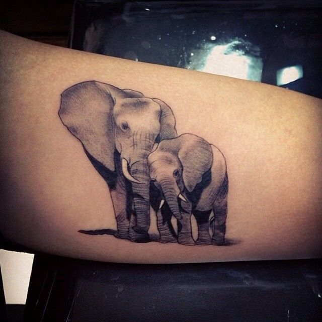 Elephant tattoo but with 3 elephants rather then 2