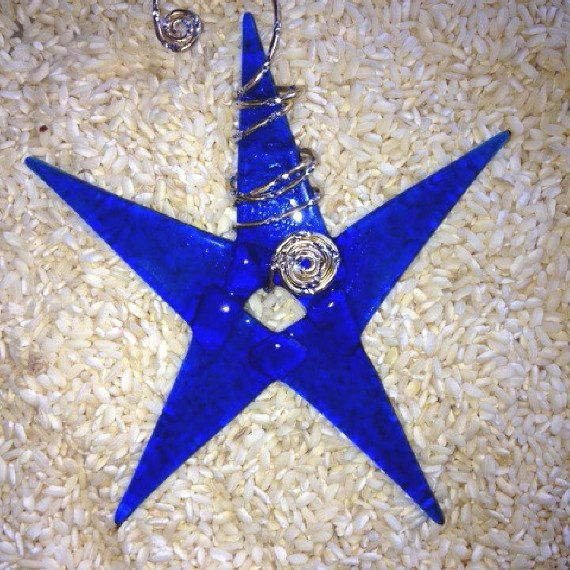 The perfect shade of transparent deep cobalt blue for anyone on your Christmas list.. This is a star that can shine brilliantly in your recipients window or in their room for inspiration. Abstract but
