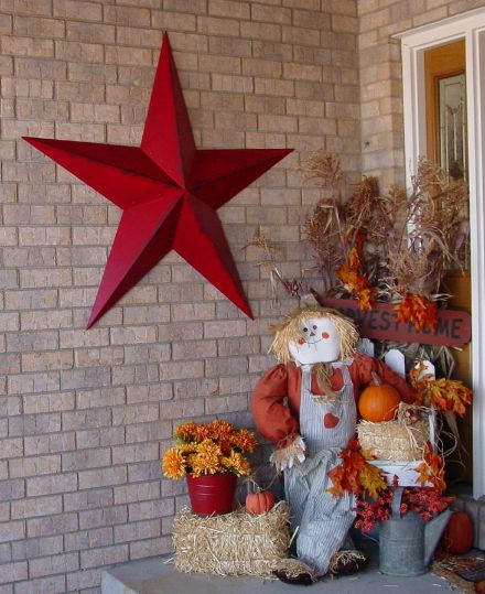 Mary created a beautiful fall display and accented with a 53 Rustic Raidiant Red Barn Star!  WOW!