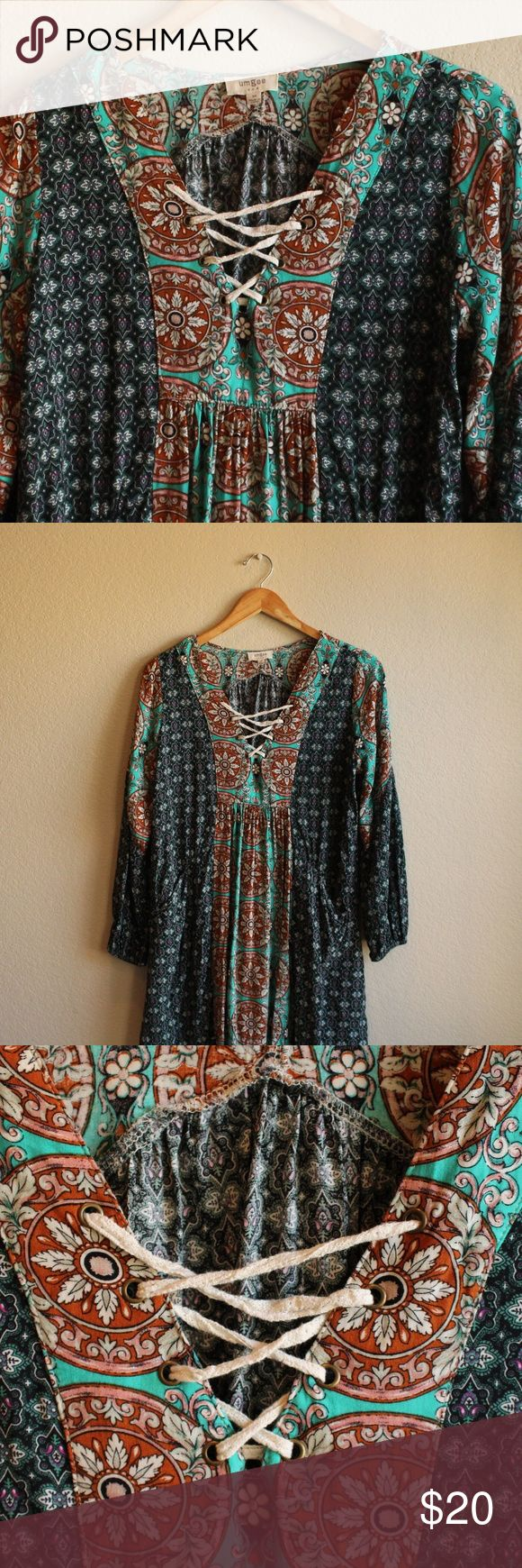 Women's Peasant Dress with Pockets Multi-color peasant dress with lace up detail in the front. This dress also has pockets! Worn and washed a few times. Very comfortable and cute with a gladiator sandal and simple cross body purse. Umgee Dresses Long Sleeve