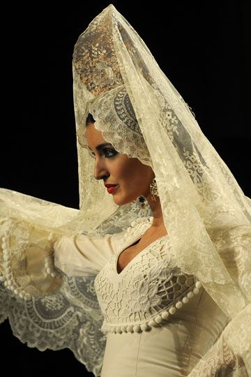 The Spanish mantilla comb worn with a bridal ensemble