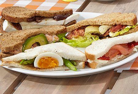 Lentesandwich met René Pluijm: Verschillende belegde broodjes met asperges, rauwe ham, artisjokken, garnalen dadels, gerookte zalm en nog veel meer lekkers.  Uit: de Coop Keukentafelgids Lente 2014.