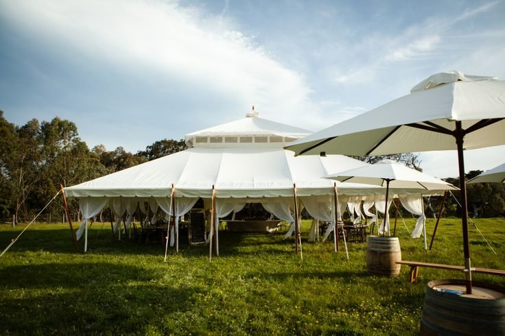Expand your space with umbrellas and seating areas around your tent. Grand 11mx11m. www.tentluxuryhire.com.au