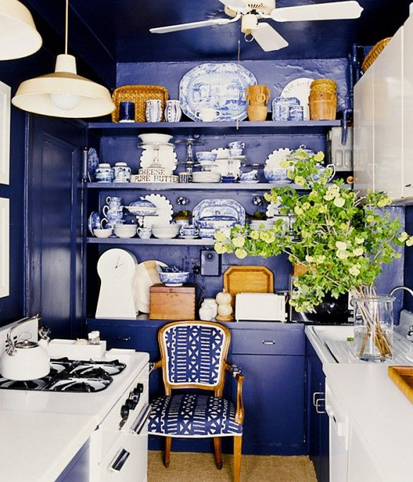 This dated little kitchen was given a sophisticated new look with rich cobalt paint, blue-and-white delftware, and wicker accents. It feels 100-percent East Hampton, although we're guessing it might be situated in a walk-up in the East Village.