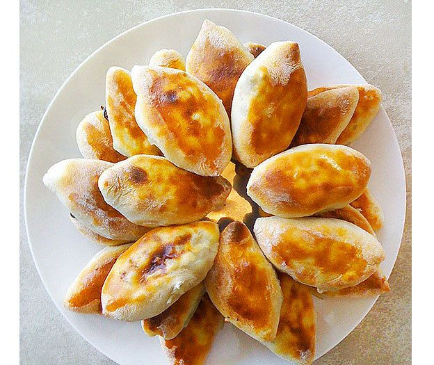 Pirozhki  is a wonderful and easy recipe for a Russian favorite, meat filled mini-pies. Typically a great pairing to any soup (especially borscht), but always delicious on their own as well.