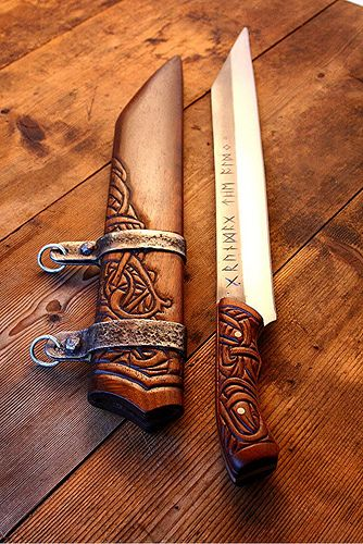 nicely carved scramasax and sheath.