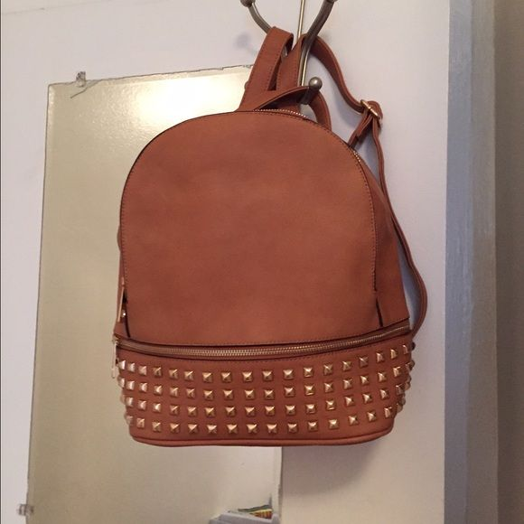 Brand new studded glamorous book bag very roomy. Brand new studded glamorous book bag very roomy.It has 4 large compartments pockets. Great to go out on the town for students to the beach or just for the statement. Looks like the Michael Kross book bag . Bags Backpacks