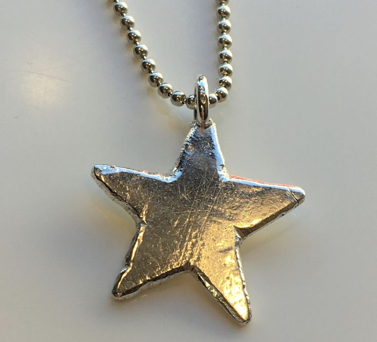 Brilliant Solid Silver Star Necklace ...hand made, unrefined, untreated, unproduced...A simple hand carved piece of English silver created by hand....wow