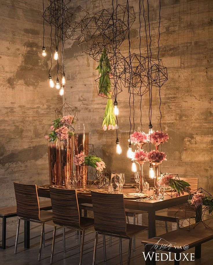 The combination of copper decor accents, pink floral arrangements, and suspended geometric structures gives a modern spin to this minimal #tablescape we can't stop admiring! See more from this #styledshoot on WedLuxe.com and in our new S/F 2016 issue that's on newsstands NOW! (: @jasalynthorne, producer, co-creative director and floral: @flowerzINC, decor: @koncept.events, dining table, chairs, benches: @loungeworks, flatware and glassware: @abpartytime)