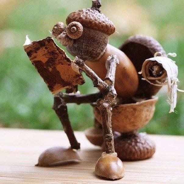 Man on toilet made of acorns