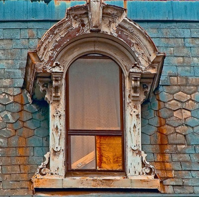 Round top dormer window on a mansard roof french style for European style windows