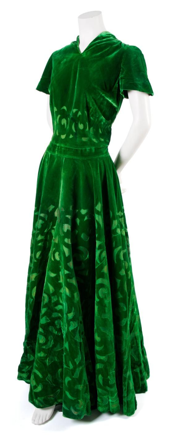 A French Couture Green Velvet Evening Gown, probably 1930s, with geometric cut-away velvet throughout.