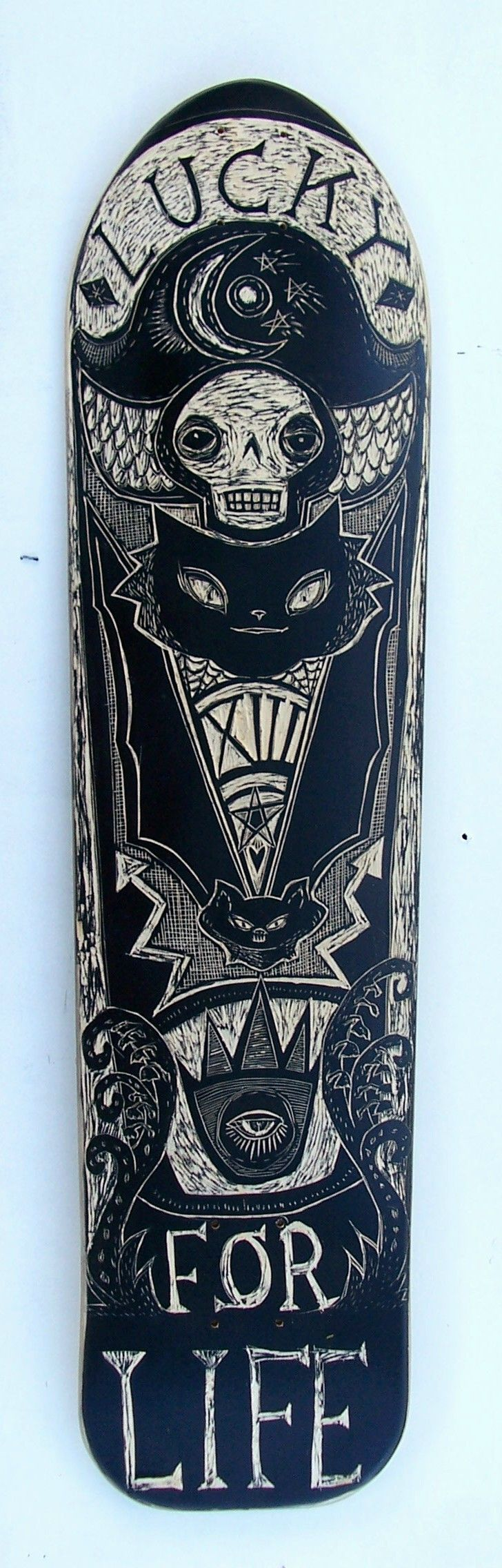 'lucky for life'  carved skate deck by coralette damme, board from local longboard company, st petersburg fl