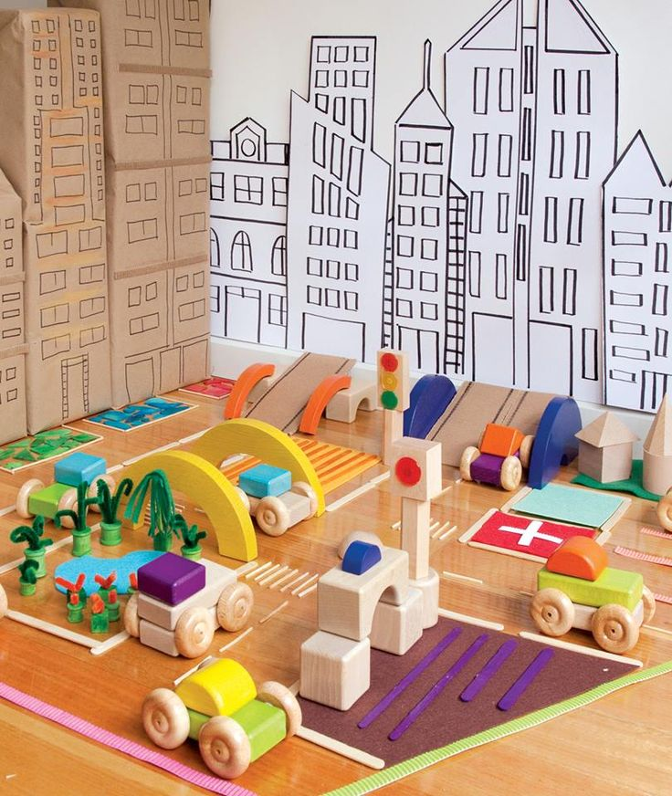 Construction play blocks and cardboard city props -shared by Zart Art Play Based Learning ≈≈ Comment by Rucker: Notice the cardboard boxes on the left - great construction area idea.