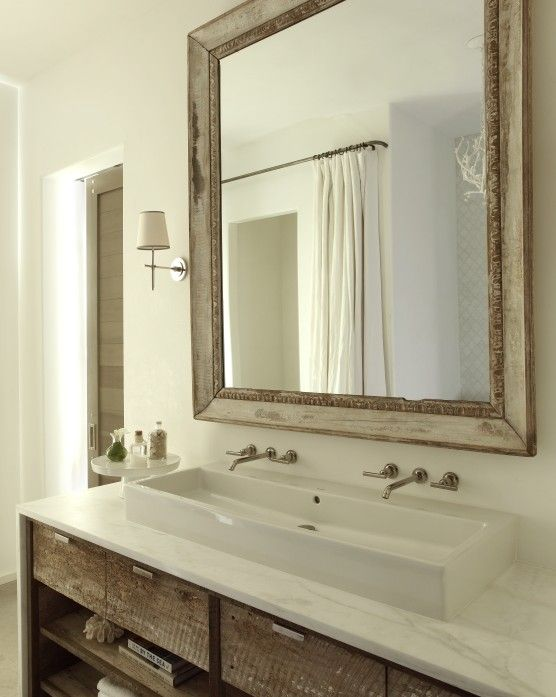 The Iron Gate: beveled wood mirror, custom built-in bathroom vanity with white vessel sink