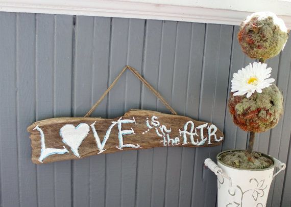 Hey, I found this really awesome Etsy listing at https://www.etsy.com/listing/185207524/driftwood-beach-wedding-sign-love-is-in
