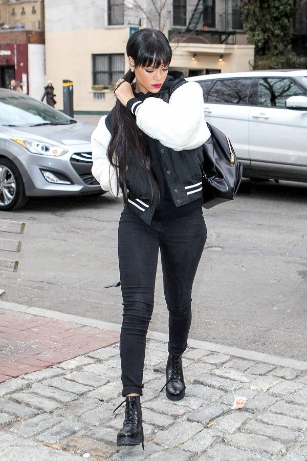 Shop this look on Lookastic: http://lookastic.com/women/looks/hoodie-and-varsity-jacket-and-skinny-jeans-and-backpack-and-boots/1637 — Black Hoodie — Black and White Varsity Jacket — Black Skinny Jeans — Black Leather Backpack — Black Leather Boots