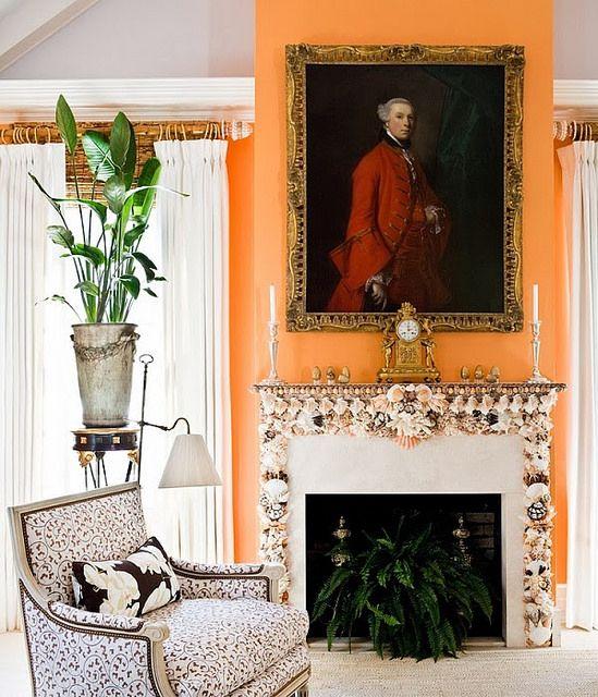 Here we go, antique portrait against a vivid orange and seashells all over the mantel. Bingo!