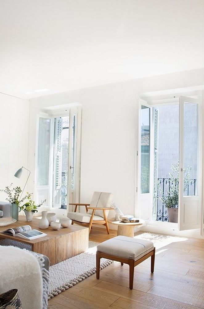 Like the white double doors and wooden floor contrast. Light and airy.