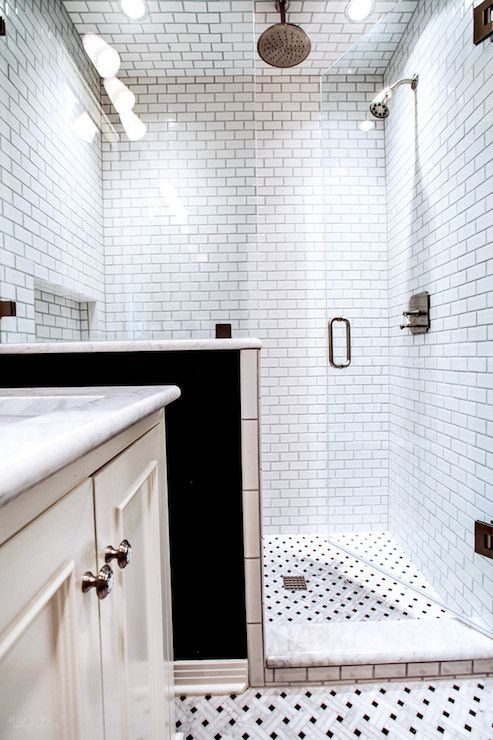 Tiles up the walls and onto the ceilings. White subway tiles. So practical in terms of bathroom moisture!