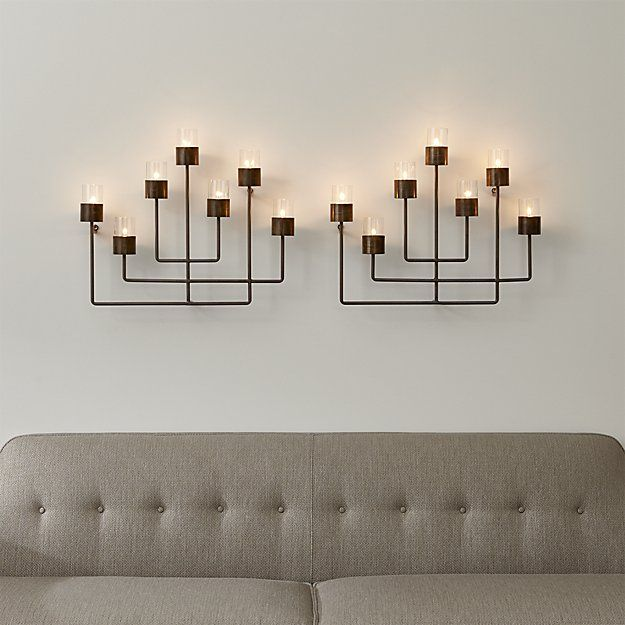 Shop Surita Wall Tea Light Candle Holder.  Steel wall candle holder crafts a seven-piece candelabra, providing mood-setting illumination and casting beautiful shadows.  Intersecting rods loft bold candle cups for tealight candles sheltered by glass shades.