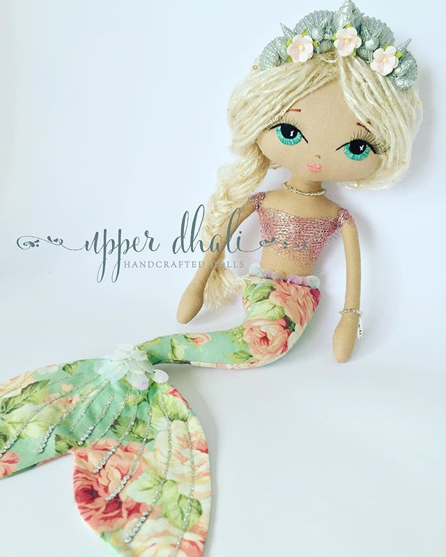 This custom order started out as a lacey mermaid until I found this fabric. I love her with this floral fabric