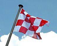De vlag van Noord-Brabant of Brabants Bont (naar het Brabants bont) bestaat uit een schaakbordpatroon met 24 vlakken in de kleuren rood en wit. De vlag wordt al sinds de Middeleeuwen gebruikt, maar raakte in de 18e eeuw in onbruik. Dankzij rijksarchivaris mr. J. Smit kwam de Brabantse vlag weer in gebruik. Sinds 1959 is het de officiële vlag van Noord-Brabant. De vlag van de provincie Antwerpen volgt eenzelfde patroon, en heeft de kleuren rood, wit, blauw en geel. www.genietenistilburg.nl