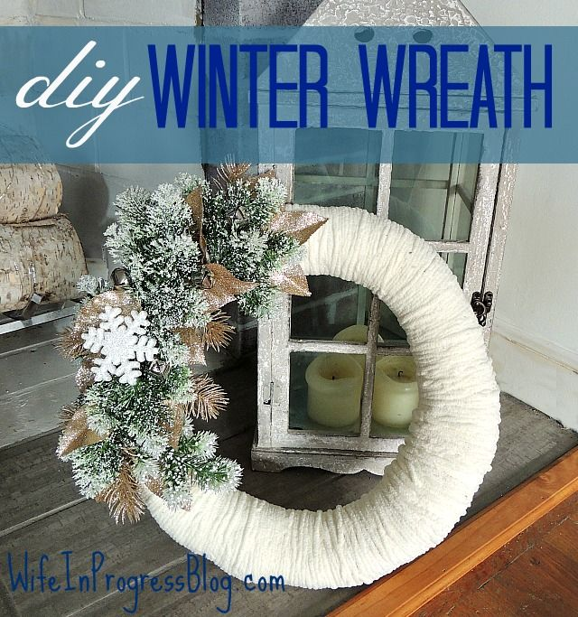 A beautiful DIY winter wreath with soft white wool and snowflakes and greenery