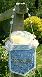 Make a cute bag with bleach stamping and a pocket cut from a pair of Jeans. Great way to re-purpose old clothes!