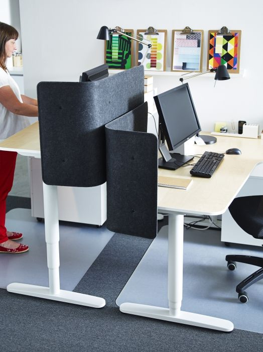 The Bekant Sit Stand Desk Can Be Raised And Lowered To